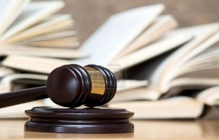 Photo for Wooden gavel and books on wooden table - Royalty Free Image