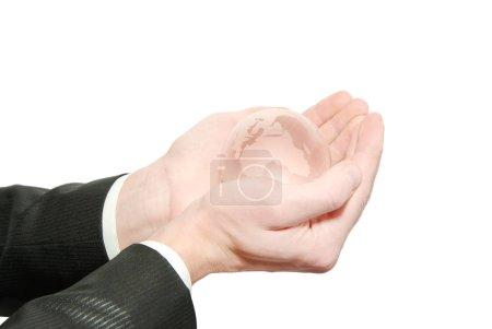 Hand holdings a globe