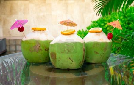 Sweet green coconuts water with drinking