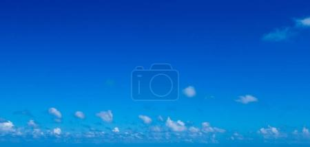 Photo for Blue sky with white cumulus clouds - Royalty Free Image