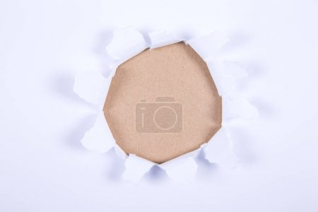 Hole in the paper with torn sides