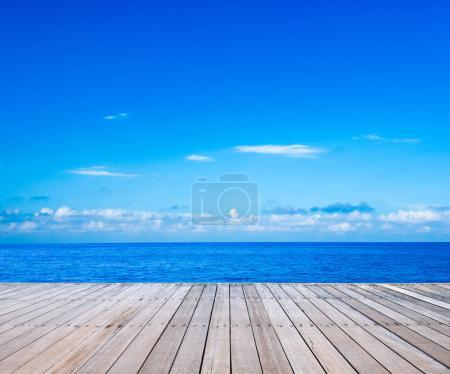 Sea and blue sky with wooden decks