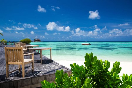 Clean sea with wooden decks and blue sky