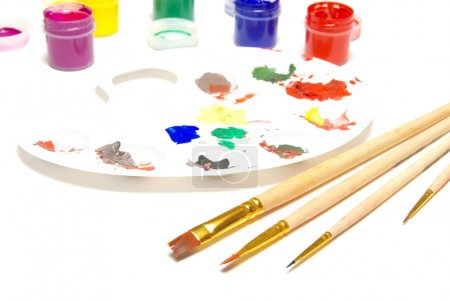 Painting brushes and paints, selective focus