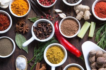 Colorful herbs and spices selection on wooden background