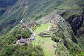 PERU, MACHU PICCHU - NOVEMBER 11, 2015: Tourists walking in Machu Picchu, UNESCO world heritage site
