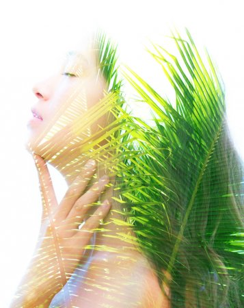 Double exposure of bright aspects of nature highlighted along female face with peaceful and relaxed expression