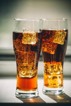 Cola with ice cubes in a glasses