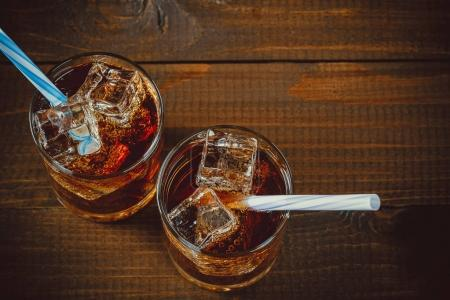 Cold drink with ice cubes in glasses