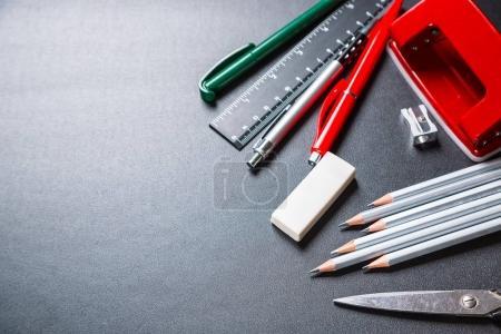 School supplies on black texture