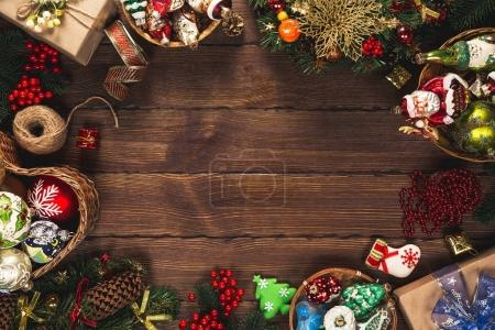 Christmas background with gifts, toys, ball, tree branches