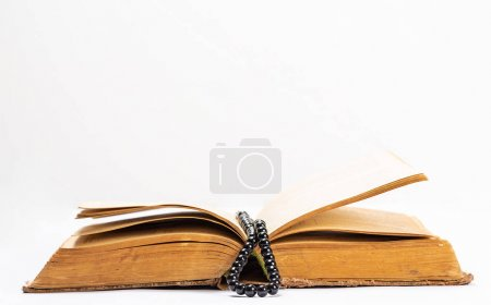 Islamic Holy Book Quran with rosary beads under soft light on White Background. Ramadan concept.Three months.