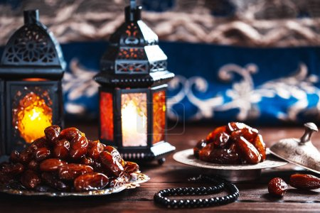 The Muslim feast of the holy month of Ramadan Kareem. Beautiful background with a shining lanterns Fanus on wooden boards. Free space for your text