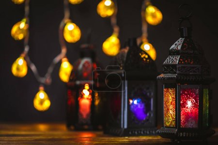 The Muslim feast of the holy month of Ramadan Kareem. Beautiful background with a shining lanterns Fanus. Free space for your text.
