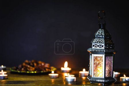 Photo for The Muslim feast of the holy month of Ramadan Kareem. Beautiful background with a shining lantern Fanus. Free space for your text. - Royalty Free Image
