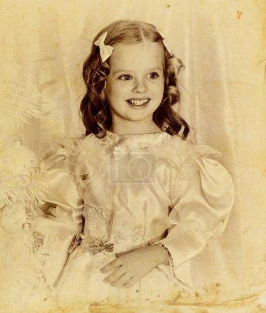 Old retro Christmas portrait of child girl.