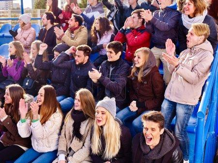 Cheering fans in stadium people applaud your favorite team.