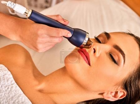 Ultrasonic facial treatment on ultrasound man face machine.