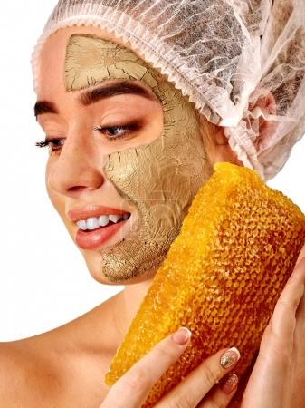 Facial honey clay face mask woman . Honeycombs homemade organic threatment.