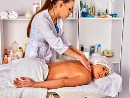 Photo for Massage room for therapy deals. Woman therapist making manual therapy neck and shoulders. Hands of masseuse treatment of spinal injuries 40 old mature client in spa salon. - Royalty Free Image