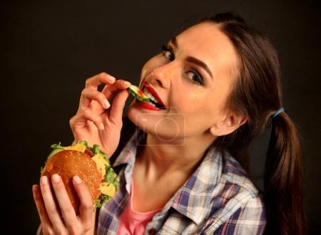 Woman eating hamburger. Girl wants to eat burger.