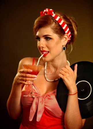 Retro woman with music vinyl record. Pin up girl drink martini cocktail