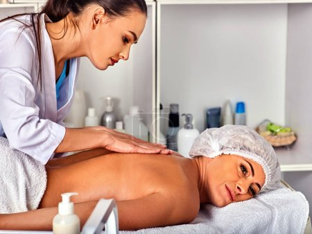 Photo for Massage woman therapist making manual therapy back. Hands of masseuse close up. Treatment of spinal injuries 40 old client in spa salon. Rejuvenating procedure. - Royalty Free Image