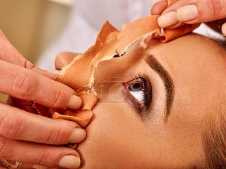 Collagen face mask . Facial skin treatment. Woman receiving cosmetic procedure.