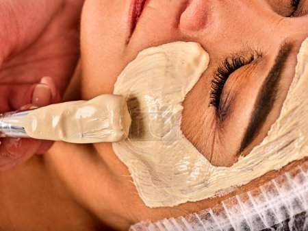 Facial massage for forty five year old woman spa salon.