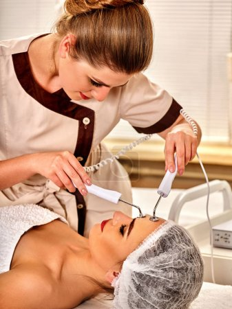 Photo for Facial massage at beauty salon. Electric stimulation skin care of woman. Professional equipment for microcurrent lift face. Anti aging rejuvenation and non surgical treatment number one. - Royalty Free Image