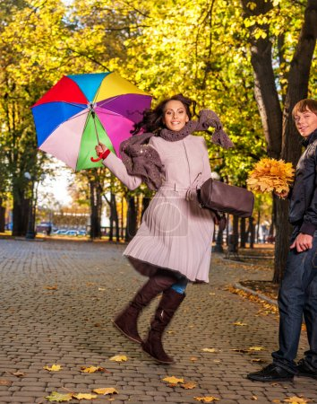 Friends in love having fun in autumn park.