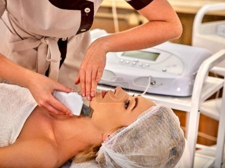 Skin resurfacing procedure on ultrasound cavitation facial peeling machine.