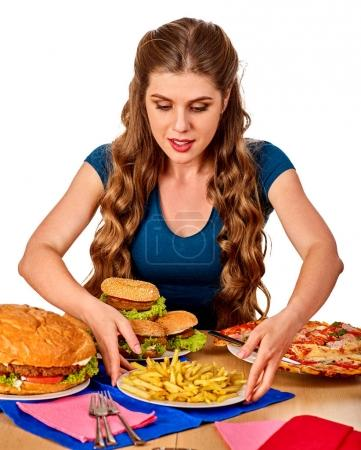 Woman eating french fries and