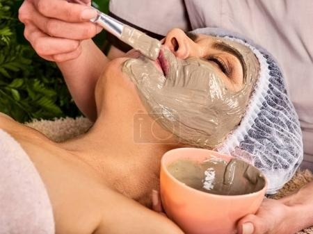 Collagen facial mask skin treatment. Elderly woman 50-60 years old.