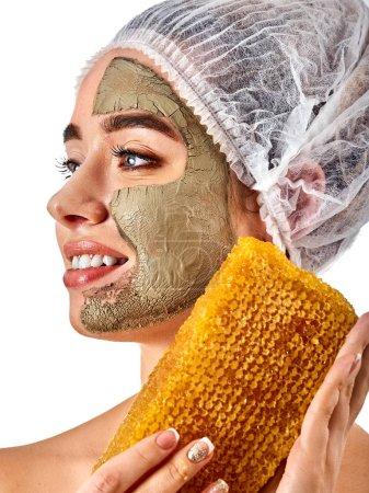 Facial honey clay face mask woman. Honeycombs homemade organic threatment.