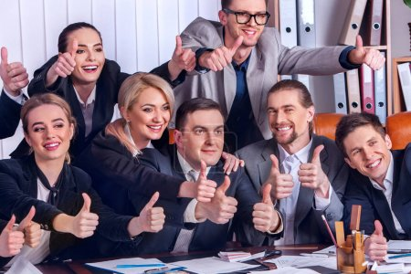 Business people office life of team people are happy with thumb up .