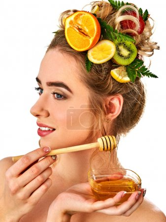 Honey facial mask with fresh fruits and honeycombs for hair .