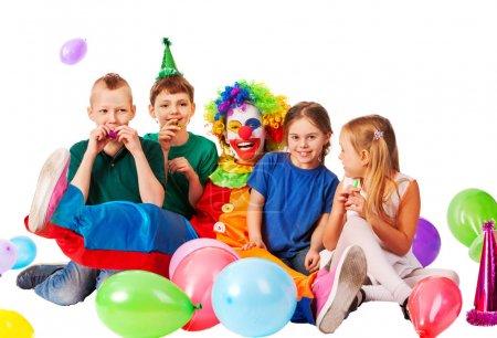 Birthday child clown playing with children. Kid holiday cakes celebratory.