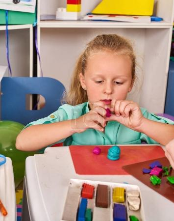 Plasticine modeling clay. Child dough play in school.