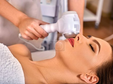 Ultrasonic facial treatment on ultrasound face machine.