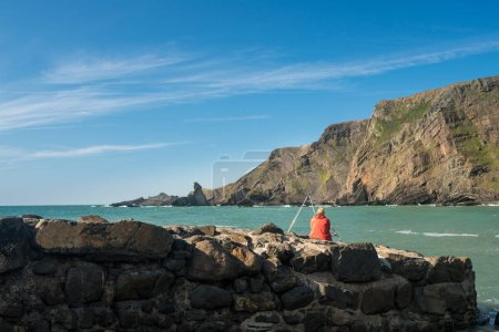 Sea angler at Hartland Quay in North Devon
