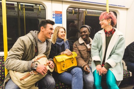 Group of friends travelling together by tube