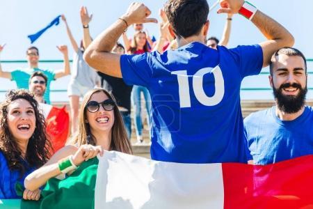 Happy Italian fans at stadium for soccer match