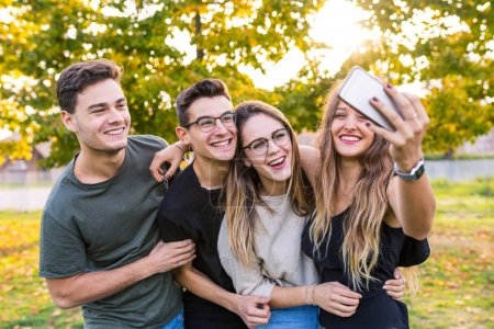 Teen friends at park taking a selfie and having fun