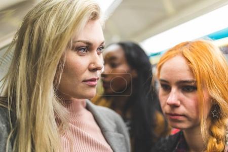 Women portrait on crowded tube train