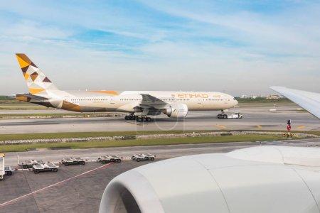 Etihad Boeing 777 on taxiway at Bangkok airport