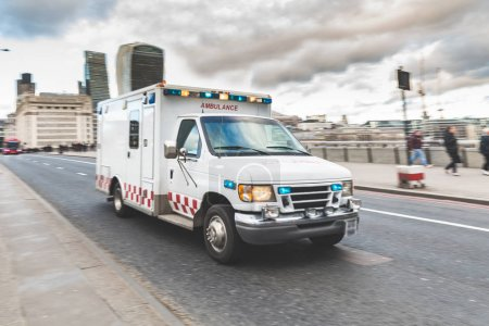 Emergency ambulance rushing on the street in London