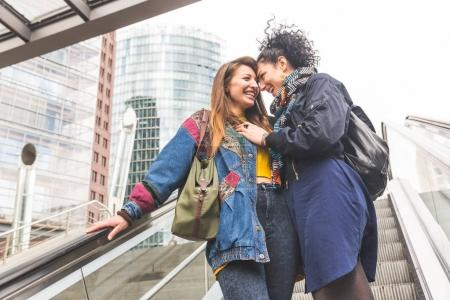 Lesbian couple in Berlin laughing and having fun together