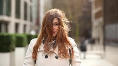 Beautiful woman with hair tousled by the wind