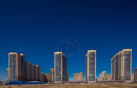 New residential apartment buildings over deep blue sky